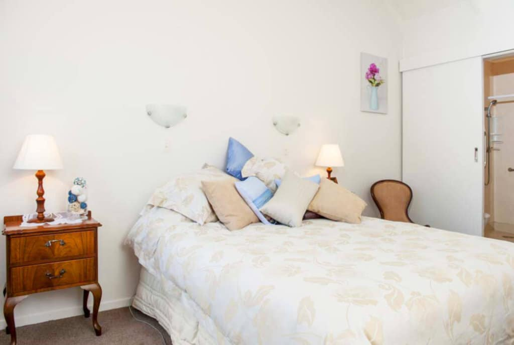 Spacious master bedroom with high ceiling and ample storage in the one bedroom villas at Abingdon Village.