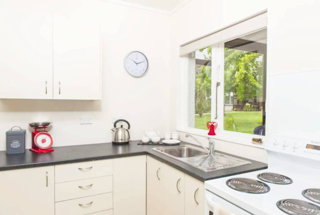 Separate, well-appointed kitchen in the one bedroom villas at Abingdon Village.