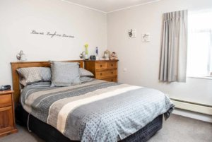 Master bedroom with double wardrobes and garden views in the two bedroom villas at Coombrae Village.
