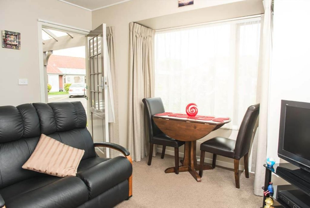 Light and bright lounge and dining area in the two bedroom villas at Coombrae Village.