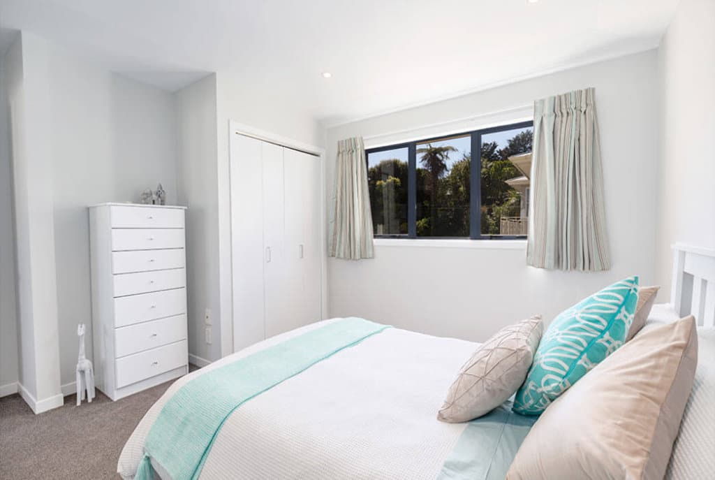 Master bedroom with double wardrobes in the two bedroom Huntleigh Apartments.