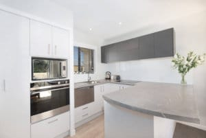 Large modern kitchen with stainless appliances in the two bedroom Huntleigh Apartments.