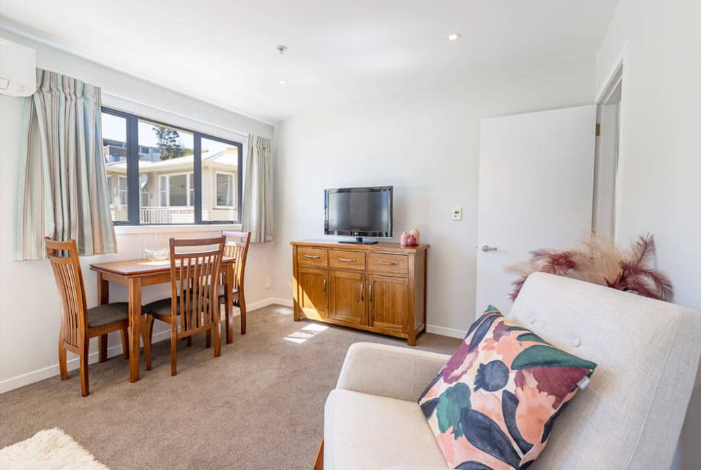 Open plan living, kitchen and dining in the two bedroom Huntleigh Apartments.