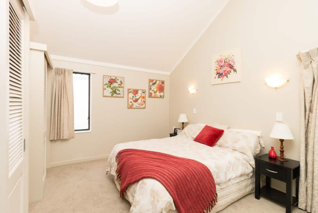 Master bedroom with double wardrobes and high ceilings in the two bedroom villas on Kowhainui Drive.