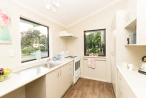 Well-appointed galley style kitchen in the two bedroom villas on Kowhainui Drive.