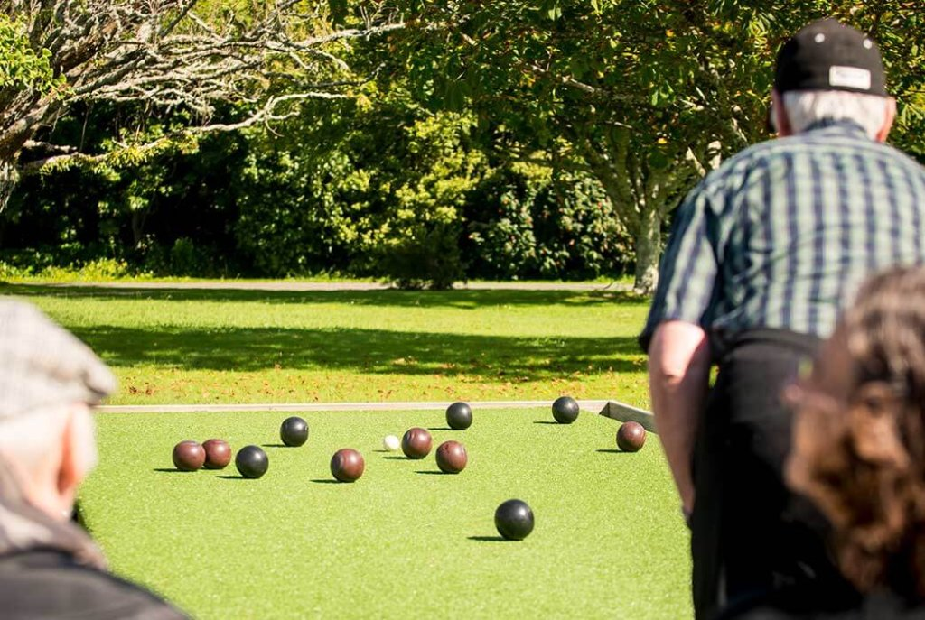 Enjoying a game of lawn bowls at sunny Levin Home.