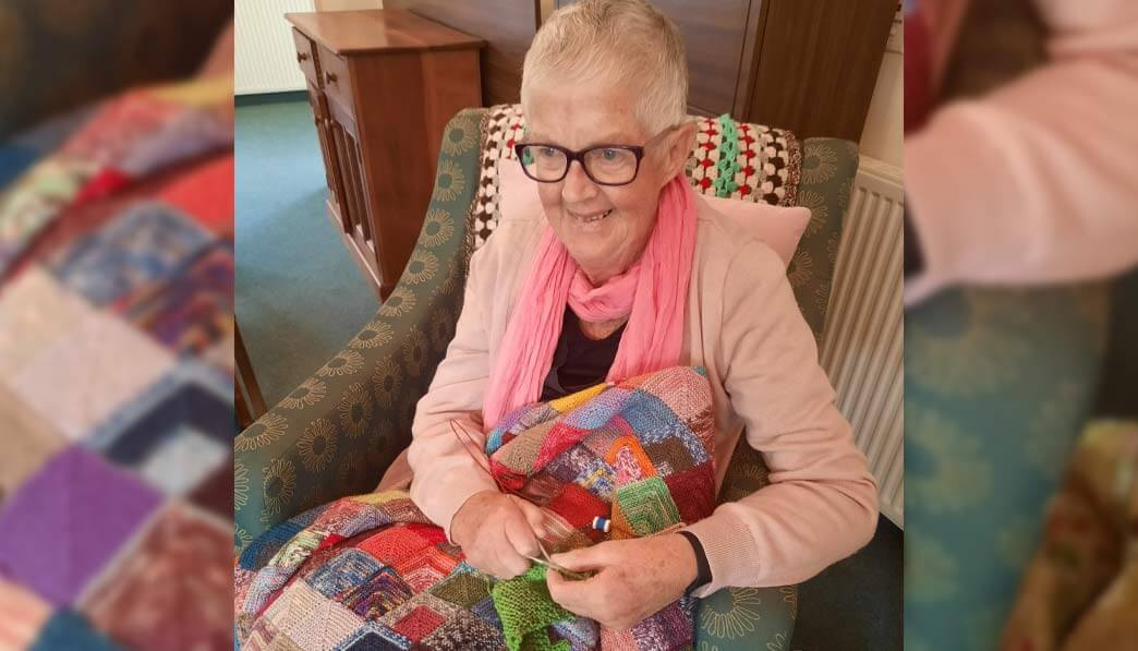 Stories and laughs shared over knitting needles